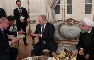 """أردوغان يقدّم """"التين الطازج"""" لبوتين وروحاني (صور)"""