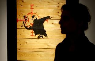 """""""بانكسي"""" المجهول يعرض لوحاته في صالة عرض جديدة ...صور"""